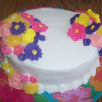 Flowers I WAS PLAYING AROUND WITH THIS CAKE. I DID END UP PUTTING LEAVES AND A BORDER ON IT...