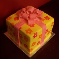 Birthday Gift Cake   Fondant covered with Wilton Brush-On color stamped on; Wilton Ribbon Embosser bow and ribbon.