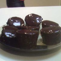 Mini Ganache Covered White Cakes mini white cakes covered in chocolate ganache for mothers day.