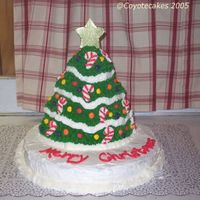 Xmas2005   Here is the xmas tree cake I made tonight for my husbands party at work.