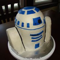 "R2D2 Cake First 3D cake. Head made with 1/2 ball cake pan, than 2 8"" rounds. Covered in buttercream and blue fondant accents."