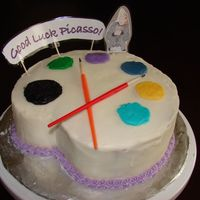 Good Luch Painter's Palette Cake My first carved cake. Made for my sister after applying to an art program. Buttercream covered cake. Picture of her is laminated photopaper...