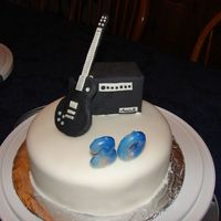 Les Paul Guitar With Marshall Amp For Brother-in-law's b-day. Fondant covered cake, gumpaste guitar and amp. I made the amp by covering a small box with gumpaste. The...