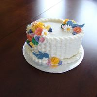 Wilton Coarse 2 Basketweave Cake Buttercream basketweave, colorflow blue birds, and royal icing flowers.