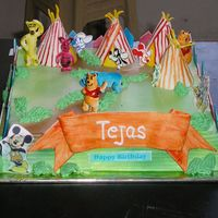 Diney Theme Carnival Cake Sugarcrafted themes made and arranged over a iced and spray painted cake