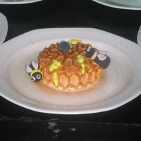 Honeybee Cake A freshcream iced miniature cake decorated as a honey comb and gumpaste honeybee arranged over it. Try having fun with flavouring it with...