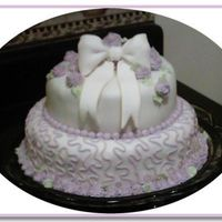 Purplebow.jpg This was my practice cake to make a fondant bow....:) I have gotten several orders to make this cake bigger for weddings.