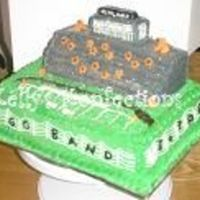 Football Stadium I did this cake for the high school band banquet this year. My brothers roped me into doing it and last years band banquet cake...both...