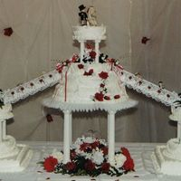 Red Rose Wedding Cake  Here is a picture of a wedding cake that me and my sister did together. We made all the flower arrangments and decorated the cake. It was a...