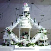 Double Staircase Cake  Here is another creation by my sister and I. This one is one of the bigger cakes that we have had to do.....The flowers were all made by us...