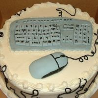 Computer Cake I made this cake for a computer guy. The keyboard and mouse are made in fondant and the cords are piped in cream cheese icing.