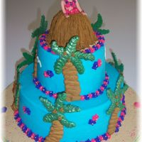 Luau Princess Cake this cake was made for my daughters 5th birthday party. She wanted a Luau Princess cake. Everything is buttercream except the palm tree...