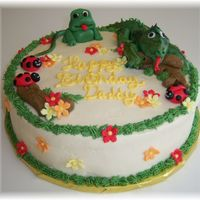 "Iguana, Frog And Lady Bugs This cake was made for a friends husband who loves Iguana's. the cake is a 10"" round iced in buttercream with buttercream grass..."