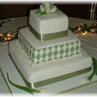 "Green And White Diamonds three tiered square cakes, 14"",10"" and 6"". Covered in white fondant. middle tier has fondant cutouts for diamonds and..."
