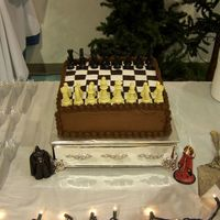 Chess Board Groom's Cake This cake 12 inch square cake has chocolate butter cream icing and the chess board is chocolate and white petinice fondant. I was going to...