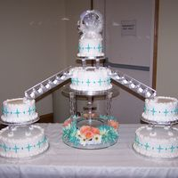Wedding Cake With Fountain And Staircase This wedding cake was for a friend of mine. It is the first time I used a staircase and I don't think I'm a fan, but it turned...