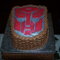 Autobot Grooms Cake Everything is butter cream except for the autobot symbol. I made everything metalic with a metalic luster dust.