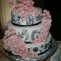 Pink Blossums   A 3 layered cake with black designs on the sides then added artificial flowers for a little kick!