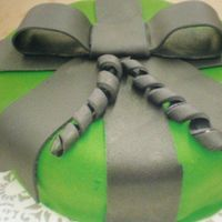 Green Gift   My friend's birtday cake. Made up of fondant. Green with black ribbon. Very fun!!