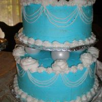 Blue And White Just a 2 tier cake with White roses. Practice