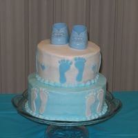 Baby Boy Booties... Made this one for my own baby shower! Buttercream with fondant footprints and store bought shoes!