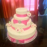 Pink Wedding Cake This is my second wedding cake.. Is a Dominican cake with fondant and gumpaste flowers...