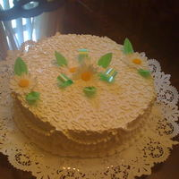 Birthday Cake i made this cake for my grandmother, she is very special for me.. the cake is dominican cake, with merengue icing, and gumpaste daisy.