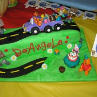 October_2006_038.jpg For my nephew's first birthday party. Long loaf cake covered in fondant. Everything else made with fondant. Took FOREVER!