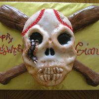 Baseball Themed Skull And Crossbones Skull carved from football cake. Bats carved from 11x7 cake. Covered in fondant. Fondant centipede and lettering. Hand painted to look old...