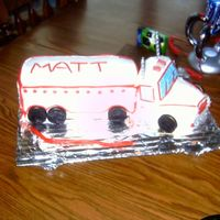 18 Wheeler B-Day Cake This was my irst attemt at making a free styled cake.. The candles are the smoke stacks..