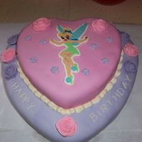 Tinker Bell 2 layer heart shaped chocolate cake. Cream cheese frosting in between layers. MMF covered. Tinker Bell is FBCT. BC Roses. Due to how her...