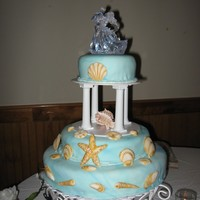 3Rd Wedding Cake blue marbled Fondant covered yellow cake. Sea shells are gumpaste.
