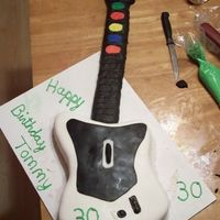 Guitar Hero Made this for my husband for his 30th birthday. He and his friends are OBSESSED with guitar hero. Chocolate cake w/ cannoli filling....
