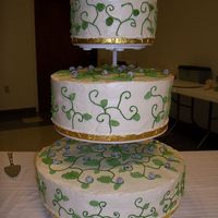 Vine Cake With Crystallized Blueberries This cake was for a 55th wedding anniversary. It is mock whipped cream icing with royal icing vines and leaves with crystallized...