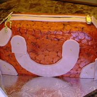 Orange Croc Purse Cake Buttercream icing and fondant accents. I let the fondant pieces dry on a cookie sheet before adding them to the cake, but that was a...