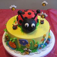 Lady Bug Cake This was done for a 4 yr old who loves Ladyu bug. Buttercream with fondant accents. Lady bug is Rice krispie.