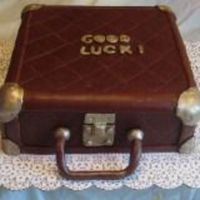 "Suitcase/luggage Cake This was done for a "" Going away"" party. The client wanted a very antique, old feel to the suitcase. This was my first attempt at..."