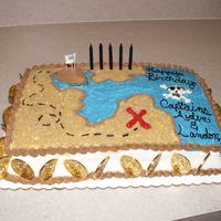 Pirate Treasure Map With Cupcakes   I don't have a good picture of the cupcakes, but here they are at the sides of the main cake