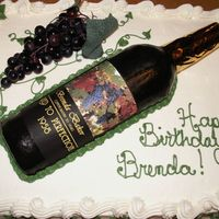 50Th Birthday Cake First attempt at a fondant wine bottle, but in a time crunch, so I used plastic grapes...
