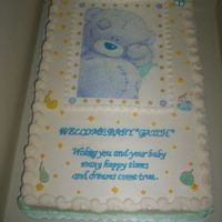Tatty Teddy   This is an edible image with baby theme candles....