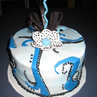 Jazzy   White and Chocolate cake with Cookies and Cream Filling, buttercream frosting. Gumpaste flower, chocolate ribbons
