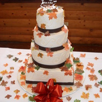 Autumn Themed Wedding Cake Buttercream with gumpaste leaves and dark chocolate clay ribbon.