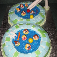 Swimming Pool Party I made this cake in 5 hours! Yikes!! I made each of my daughter's friends out of fondant. You could tell who they were by their...