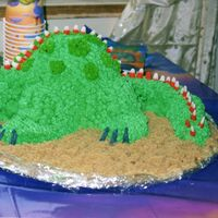 3D Dino   Buttercream 3D Dino for a 3rd birthday. Candy corns for spikes.