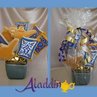 Aladdin Cookie Bouquet For a young girl who starred in community Aladdin production. Shapes were cut by hand from clipart image pulled from internet.