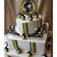 Ice Hockey Ice Cream Cake Ice cream cake, whipped icing. MMF penguins, gumpaste plaque and skates painted with luster dust. Skate eyelets are royal icing