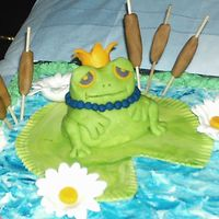 Close Up Of Frog this frogs was made of all fondant and the cat tails were fondant on skewers.