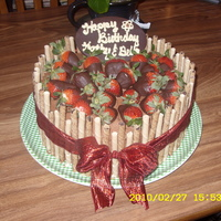 Strawberry Basket Gold cake, Chocolate Buttercream Frosting, Chocolate dipped strawberries, and Piroet Cookie trim. For friends Bday.