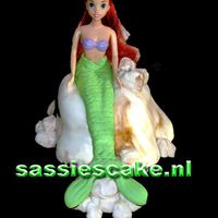 Ariel A Disney kind of cake, Ariel the mermaid.Made of a Barbie doll, covered with fondant (sugarpaste) filled with chocolate mousse.The rock was...