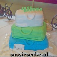 Honeymoon Suitcases Hello,i am again busy,busy,busy.This is a three layered suitcase cake with fresh colours.All suitcases are covered with sugarpaste.The...